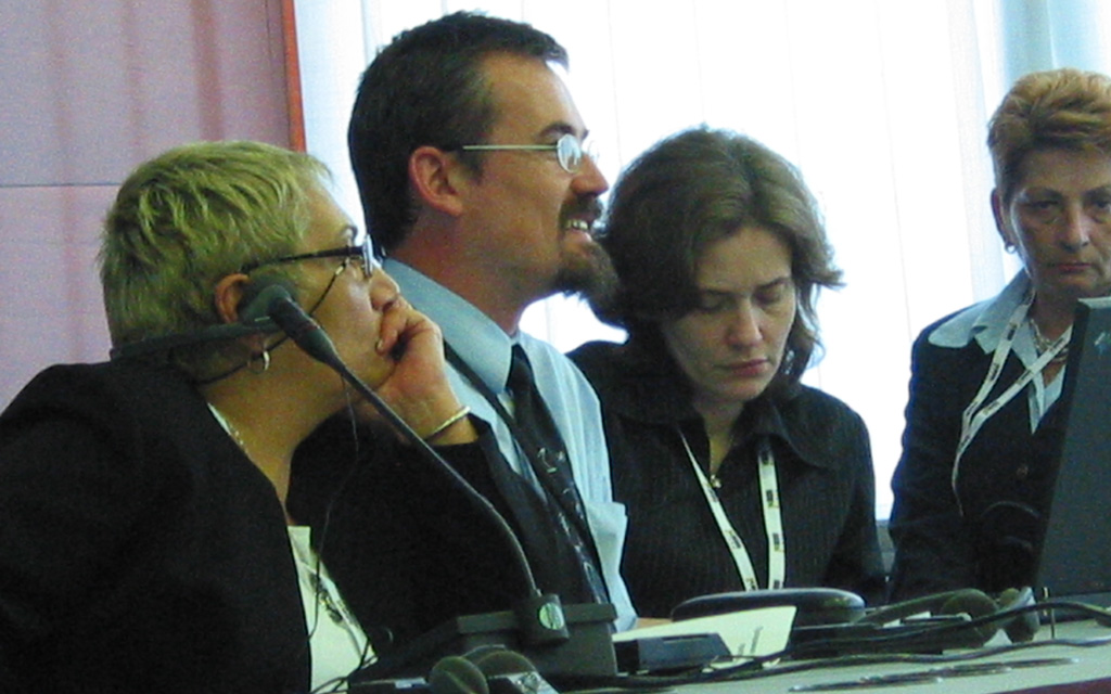 Four people at a conference.