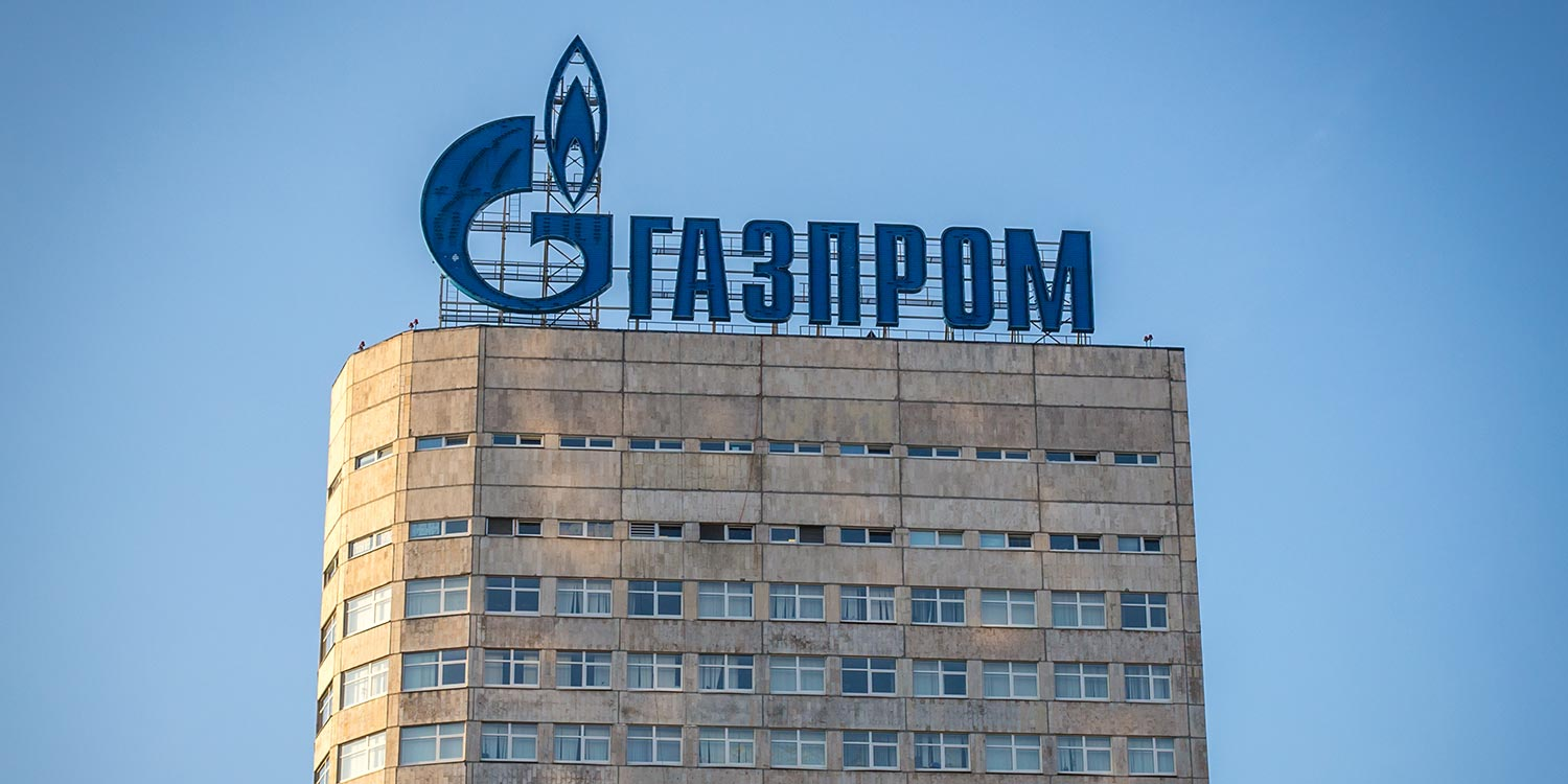 An old office building with a Gazprom sign on top.